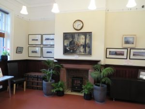 "To mark this special occasion Duglad Cameron produced new paintings of the 1865 station and pier in action - seen above, on the right of the fireplace. On the left are paintings of Caledonian Railway locomotives. Above the mantelpiece is a painting of Central Station, Glasgow in January, 1964, entitled ""A Time of Transition""."